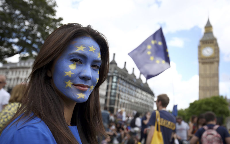 A woman with a painted face poses for a photograph during a 'March for Europe' demonstration against Britain's decision to leave the European Union, in central London, Britain, on Saturday, July 2, 2016. Britain voted to leave the European Union in the EU Brexit referendum. Photo: Reuters