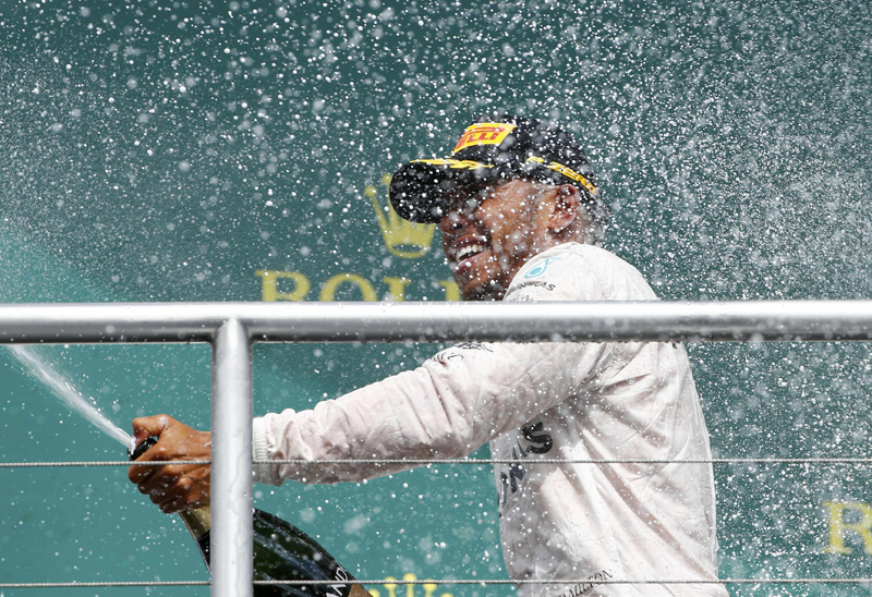 Mercedes' Lewis Hamilton sprays champagne after the Germany Formula One - F1 - German Grand Prix 2016 at Hockenheimring, Germany on July 31, 2016. Photo: Reuters
