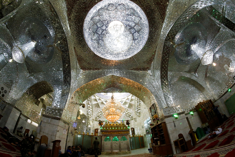 Pilgrims at the tomb of shi'ite Sayid Mohammed bin Ali al-Hadi in his mausoleum in Balad, north of Baghdad, Iraq on July 8, 2016. Photo: REUTERS