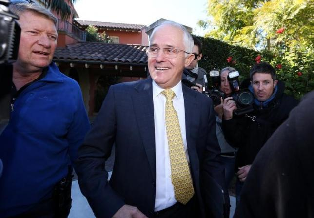 Australian Prime Minister Malcolm Turnbull smiles as he is surrounded by members of the media departing his home located in the Sydney suburb of Point Piper, Australia, July 3, 2016. AAP/David Moir/via REUTERS