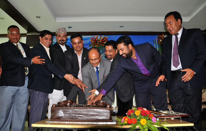 Mega Bank Nepal Chairman Bhoj Bahadur Shah (centre) cuts a cake during the 6th anniversary function of the Bank in Kamaladi, Kathmandu on Friday, July 22, 2016. Photo: Balkrishna Thapa Chhetri/THT