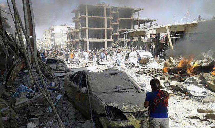 Syrians inspect damages after deadly twin bombings struck the town of Qamishli, Syria on Wednesday, July 27, 2016. Photo: AP