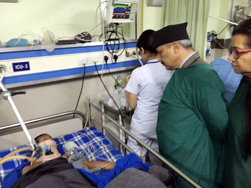 Minister for Education Giriraj Mani Pokharel visits B&B Hospital to know the condition of students injured after a compound wall collapsed and hit prefab classrooms of Pushpanjali Secondary School in Taukhel of Lalitpur, on Friday, July 1, 2016. Photo: The Ministeru2019s Secretariat