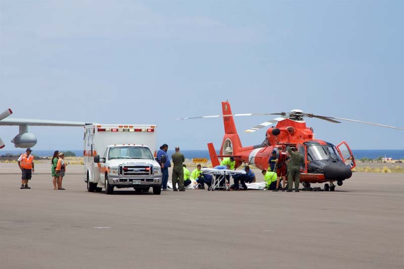 Coast Guard crews safely deliver David McMahon and Sidney Uemoto to emergency medical personnel, following their rescue nine miles off Kona, Hawaii on Friday, July 15, 2016. Photo: AP