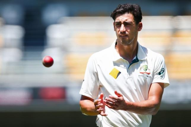 Australian bowler Mitchell Starc receives the ball, during the first cricket test match between Australia and New Zealand in Brisbane November 7, 2015. REUTERS/Patrick Hamilton/Files