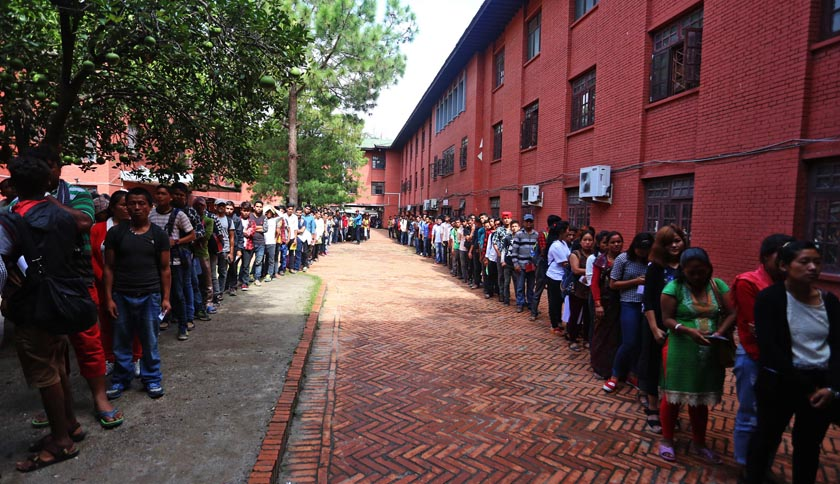 People queuing up to collect their Machine Readable Passports ( MRPs) at the FILE- Department of Passport at Narayanhiti in Kathmandu on Sunday, July 3, 2016. Photo: RSS