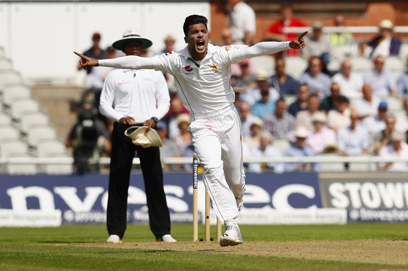 Pakistan's Mohammad Amir celebrates after bowling England's Alex Halesn during Second Test cricket match at Old Trafford in England, on Friday, July 22, 2016. Photo: Reuters
