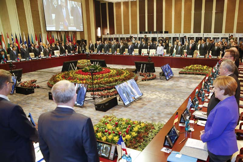 Leaders stand for a minute of silence for the victims of a deadly attack in the French city of Nice, before the opening session of the Asia-Europe Meeting (ASEM) summit in Ulaanbaatar, Mongolia, Friday on July 15, 2016. Photo: AP