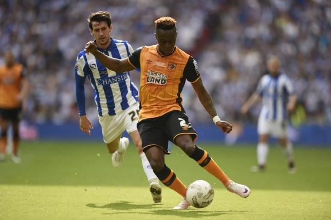 Britain Soccer Football - Hull City v Sheffield Wednesday - Sky Bet Football League Championship Play-Off Final - Wembley Stadium - 28/5/16nHull City's Moses Odubajo in action with Sheffield Wednesday's Kieran LeenAction Images via Reuters / Tony O'BriennLivepic/Files