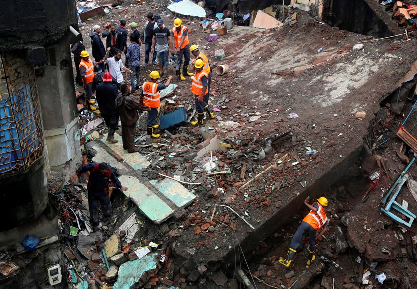 Rescuers search for survivors at the site of a collapsed residential building on the outskirts of Mumbai, India, July 31, 2016. Reuters
