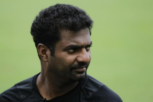 Muttiah Muralitharan looks on during an interview with media at Singapore Cricket Club October 13, 2012.  REUTERS/Tim Chong/Files