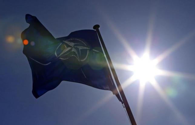 A NATO flag flies at the Alliance headquarters in Brussels during a NATO ambassadors meeting on the situation in Ukraine and the Crimea region, March 2, 2014. REUTERS/Yves Herman/Files