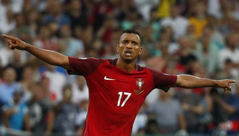 Portugal's Nani celebrates scoring during the penalty shootoutn. Photo: Reuters