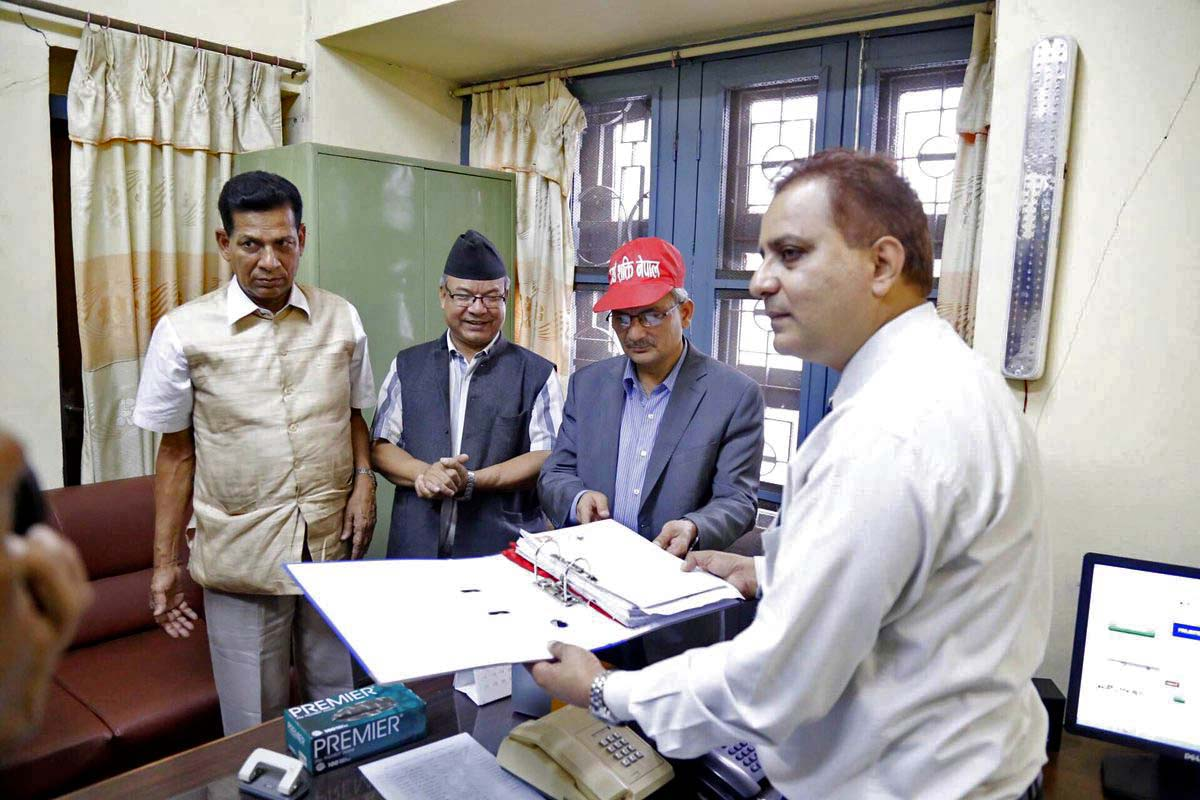 Naya Shakti Nepal Coordinator Baburam Bhattarai (2nd from right) hands over details of the party to an official of the Election Commission, in Kathmandu, on Sunday, July 10, 2016. Photo Courtesy: Naya Shakti Nepal