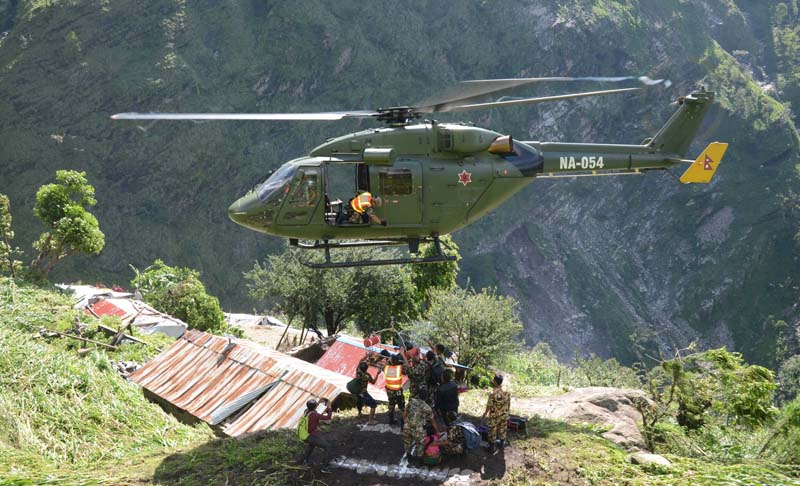 A Nepal Army helicopter airlifts seven persons, trapped in a landslide, from Ri village of Dhading district, on Sunday, July 3, 2016. Photo: Nepal Army