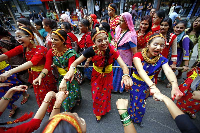 Devotees dressed in traditional attires dance and sing while taking part in the Jagannath Rath Yatra, a chariot festival, organised by ISKCON Nepal in New Road, Kathmandu, on Thursday, July 28, 2016. Photo: Skanda Gautam/ THT