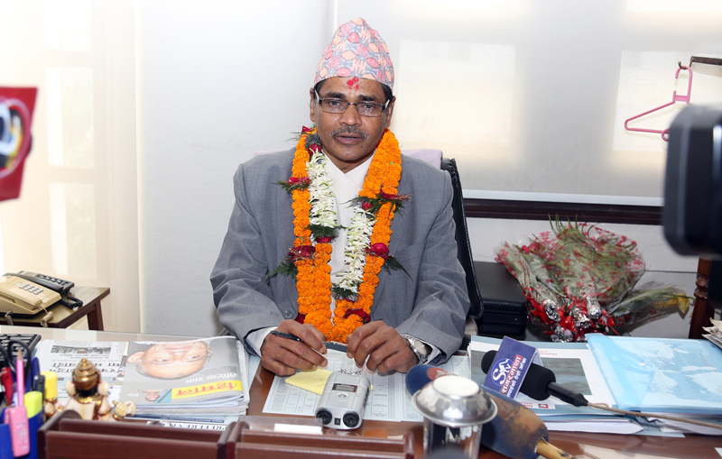 FILE: Newly appointed Chief Election Commissioner Ayodhi Prasad Yadav assumes office at the Election Commission, in Kathmandu, on Monday, July 11, 2016. Photo: RSS