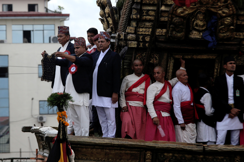 A Guthi Sansthan official displays the black jewel-studded bhoto of  Rato Machhindranath, during the Rato Machhindranath Bhoto Jatra Festival, in Lalitpur, on Friday, July 29, 2016. Photo: RSS