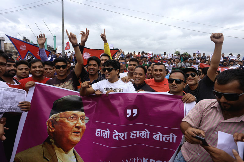 Protestors chant slogans and show placards in support of PM KP Sharma Oli at the rally organised at Maitighar Mandala in the capital on Friday July 15, 2016. Photo: RSS
