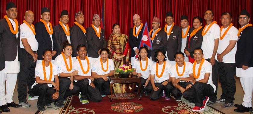 Nepal's Rio Olympic Games squad members pose for a photo with President Bidhya Devi Bhandari at the President's Office in Kathmandu on Tuesday. Photo: THT