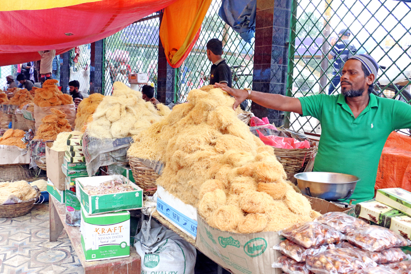 Vendors sells traditional delicacies of the Muslim community on the occassion of Eid al-Fitr festival,in Kathmandu, on Wednesday, July 6, 2016. Photo: RSS