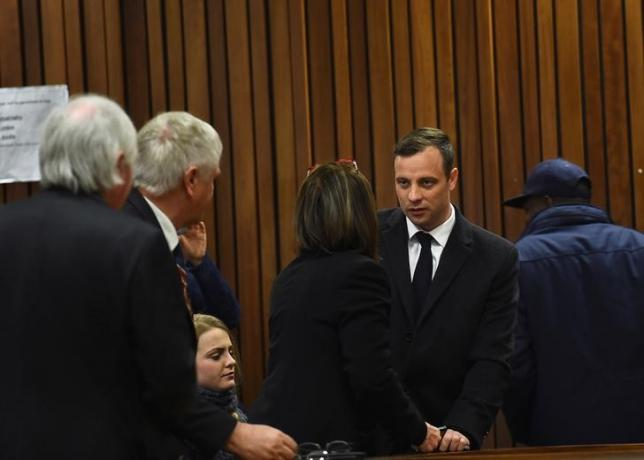 Olympic and Paralympic track star Oscar Pistorius speaks with his legal team at the North Gauteng High Court in Pretoria, South Africa, July 6, 2016. REUTERS/Masi Losi/Pool