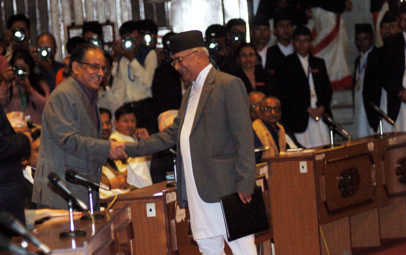 PM KP Sharma Oli shakes hands with CPN Maoist Centre Chairman Pushpa Kamal Dahal after announcing his resignation at the Parliament, on Sunday, July 24, 2016. Photo: Dhruba Ale