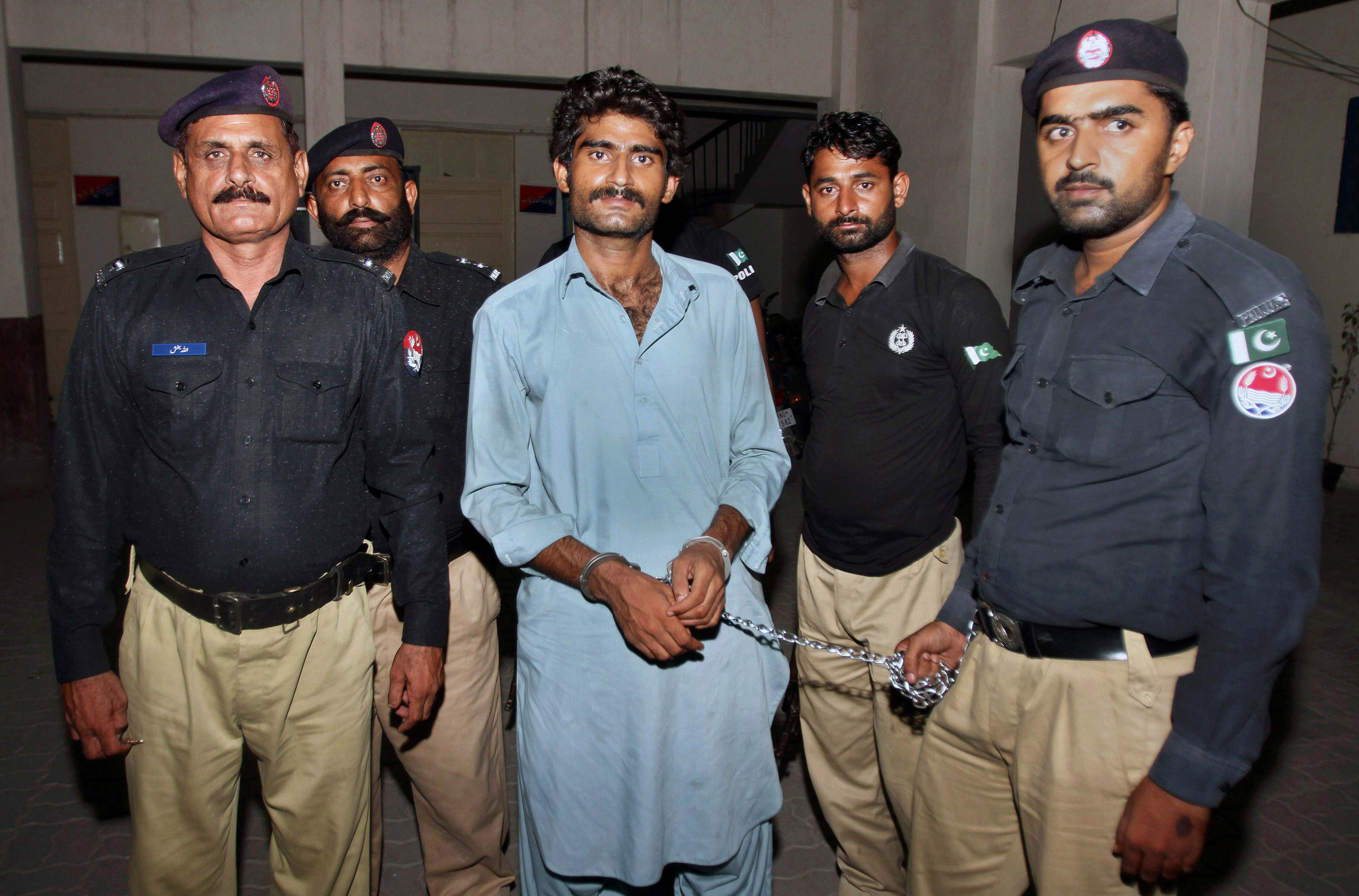 Pakistani police officers present Waseem Azeem, the brother of slain model Qandeel Baloch, before the media following his arrest at a police station in Multan, Pakistan on Sunday, July 17, 2016. Photo: AP
