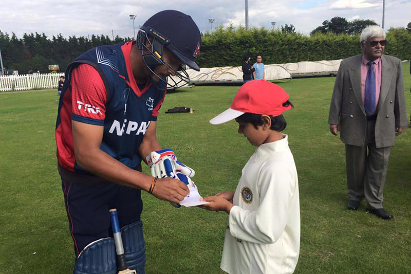 Nepal's skipper Paras Khadka gives autograph to a young fan at the Indian Gymkhana Club's home ground. nPhoto: Indian Gymkhana Club