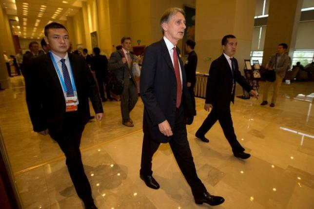 Britain's Chancellor of the Exchequer Philip Hammond (C) walks to a meeting during the G20 Finance Ministers and Central Bank Governors conference held in Chengdu in Southwestern China's Sichuan province, July 23, 2016. REUTERS/Ng Han Guan/Pool