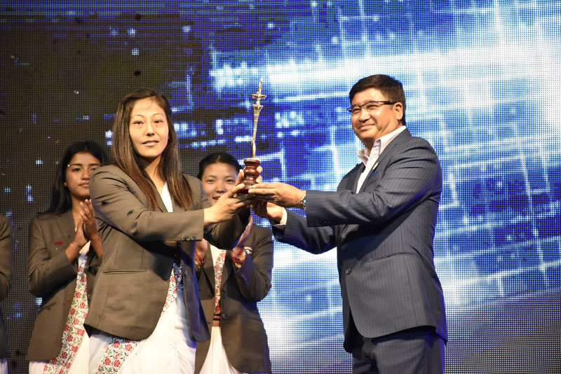 Judoka Phupu Lama Gharti receives the Female Player of the Year Award at the NSJF Pulsar Sports Award at the Nepal Academy Hall in Kathmandu on Thursday July 21, 2016. Photo: Naresh Shrestha