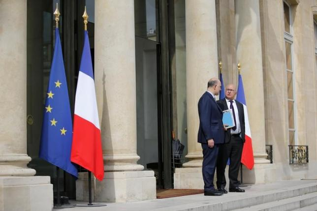 European Economic and Financial Affairs Commissioner Pierre Moscovici (L) and French Finance Minister Michel Sapin  leave a meeting after Britain voted to leave the European Union, at the Elysee Palace in Paris, France, June 24, 2016.  REUTERS/Stephane Mahe/Files