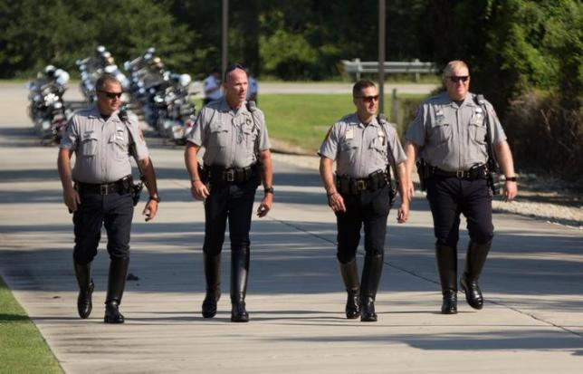 Motorcycle patrolmen arrive to the funeral services for police officer Matthew Gerald, one of three officers killed by a gunman on July 17, at Healing Place Church in Baton Rouge, Louisiana, U.S. July 22, 2016.  REUTERS/Jeffrey Dubinsky