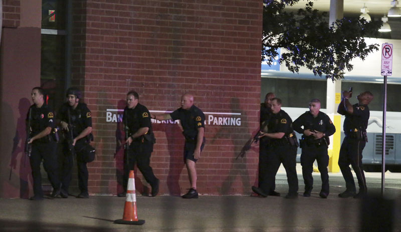 FILE - Dallas police respond after shots were fired during a protest over recent fatal shootings by police in Louisiana and Minnesota, in Dallas, on Thursday, July 7, 2016. Phtoo: Maria R Olivas/The Dallas Morning News via AP