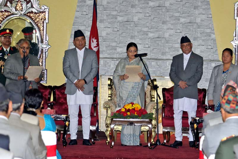 President Bidya Devi Bhandari (centre) administers the oath of office and secrecy to newly appointed Chief Justice Sushila Karki (left) at the President's Office, Sheetal Niwas, on Monday, July 11, 2016. Photo: RSS