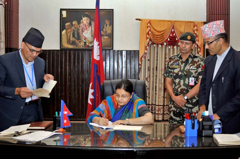 President Bidya Devi Bhandari enacts three bills passed by the Legislature-Parliament on various dates, at her residential office, Sheetal Niwas, in Kathmandu, on Thursday, July 14, 2016. Photo: RSS