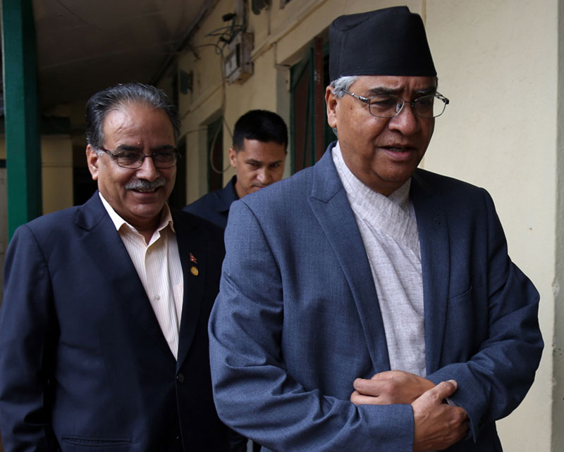 CPN Maoist Centre Chairman Pushpa Kamal Dahal (L) and Nepali Congress (NC) President Sher Bahadur Deuba heading to towards the NC's Parliamentary Party office to take part in a meeting in Singha Durbar of the Capital on Friday, July 22, 2016. Photo: RSS
