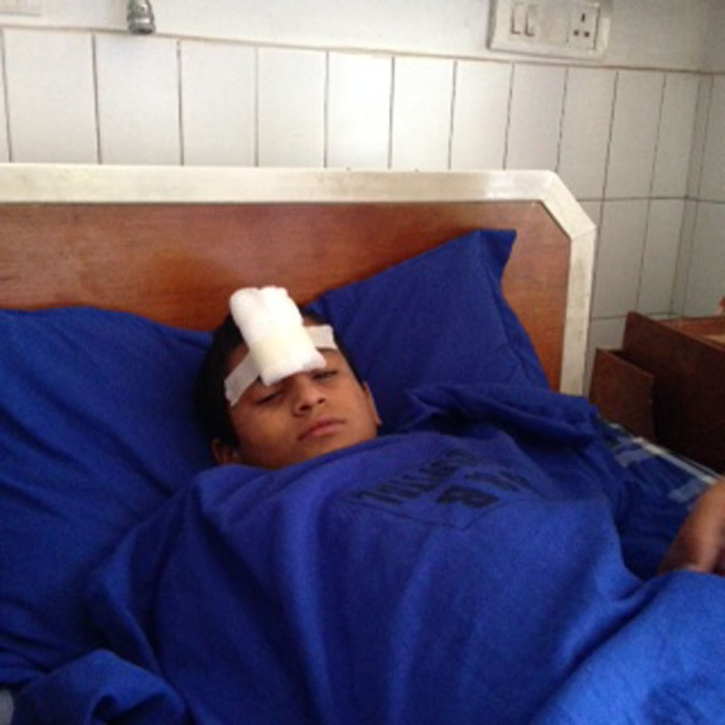 A student, injured in a wall collapse at the Pushpanjali Secondary School, undergoing treatment at the B&B Hospital in Lalitpur, on Friday, July 1, 2016. Photo: Kokila KC