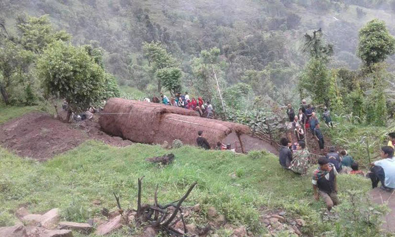 Locals gather near Durga Bahadur Malla's house that was hit by a landslide, killing five members of Malla's family in Rajwara VDC of Pyuthan. Photo: THT
