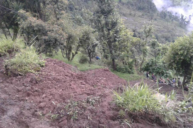 Locals gather near the house which was buried by a landslide, killing five members of a family, in Rajwara-3 of Pyuthan district, on Tuesday, July 5, 2016. Photo: RSS