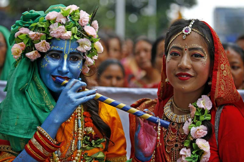A couple dressed as Radha-Krishna take part in the Jagannath Rath Yatra, a chariot festival, organised by ISKCON Nepal in New Road, Kathmandu, on Thursday, July 28, 2016. Photo: Skanda Gautam/ THT