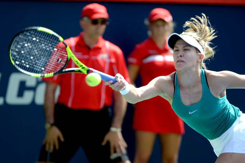 Eugenie Bouchard of Canada returns the ball against Lucie Safarova of the Czech Republic during women's first round Rogers Cup tennis action in Montreal on Tuesday, July 26, 2016. Photo: Paul Chiasson/The Canadian Press via AP
