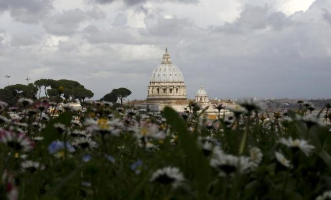 Saint Peter's Basilica at the Vatican is seen from a hilltop in Rome, March 11, 2013. REUTERS/Paul Hanna/Files