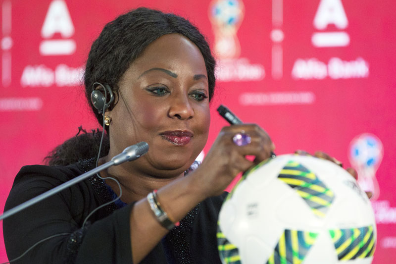 FIFA Secretary General Fatma Samoura signs an official FIFA tournament ball during a news conference in Moscow, Russia, on Monday, July 18, 2016, during the FIFA sponsorship event with Russian Alfa Bank. Photo: AP