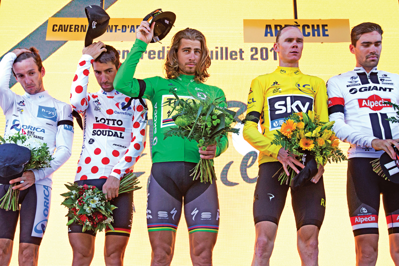(From left) Britainu2019s Adam Yates, Belgiumu2019s Thomas de Gendt, Peter Sagan of Slovakia, Britain's Chris Froome and Stage winner Netherlandsu2019 Tom Dumoulin observe a minute of silence to commemorate the victims of the Nice truck attack after the thirteenth stage of the Tour de France cycling race in La Caverne du Pont-d'Arc on Friday, July 15, 2016. Photo: AP
