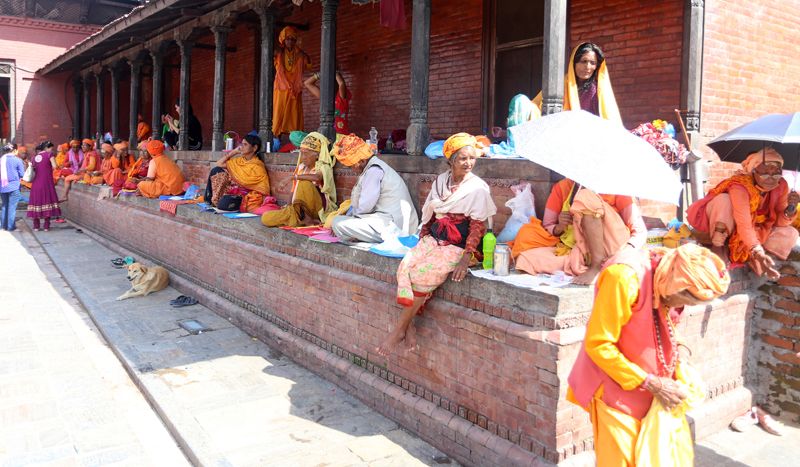 Sadhus and senior citizens rest in front of the Pashupatinath Temple in Kathmandu, on Saturday, July 9, 2016. Photo: RSS