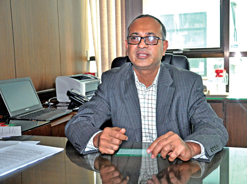 Sanima Bank CEO Bhuvan Kumar Dahal insights into how provisions laid in the policy would affect banks and financial institutions at Narayan Chaur in Kathmandu on Sunday, July 17, 2016. Photo: Balkrishna Thapa Chhetri