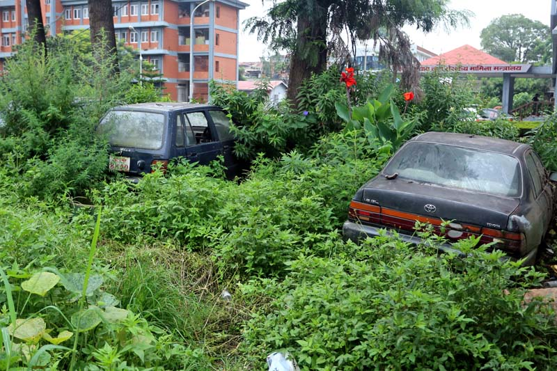 Scrapped cars parked inside the premises of Singhadurbar, in Kathmandu, on Sunday, July 31, 2016. There are hundreds of vehicles in the similar condition in the central administrative complex of the nation. Photo: RSS