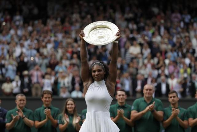 Britain Tennis - Wimbledon - All England Lawn Tennis & Croquet Club, Wimbledon, England - 9/7/16 USA's Serena Williams celebrates winning her womens singles final match against Germany's Angelique Kerber with the trophy REUTERS/Andrew Couldridge
