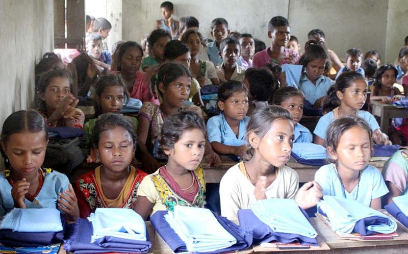 Pupils of Shree Nepal Rastriya Primary School in Birgunj Metropolitan City-25 receive uniform, on July 8, 2016. Photo: Ram Sarraf